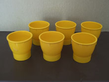 Coloured egg cups, orange and yellow