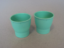 Coloured egg cups, green/blue pair
