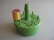Different vintage cotton reel holder