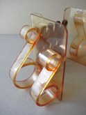 Close up of Lucite book rack
